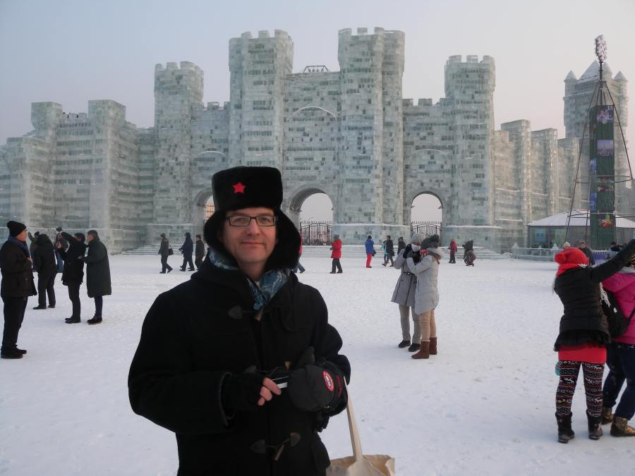 aspiring member of communist party central committee, who strangely shadowed me around Harbin, in front of impressive ice castle