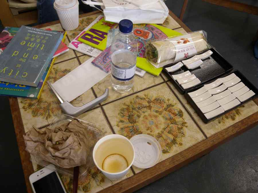 Discussion of upcoming exhibition in Unit Gallery, so far categorised as works in progress and the nascent audience and coffee table accordingly covered in related stuff, in other words a living record of productivity, a still life.