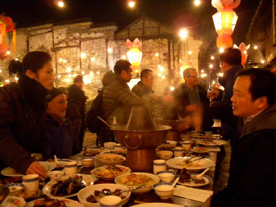 dinner in the street with the client/important Wuzhen boss. Filmed by CCTV as part of their usual spring festival coverage