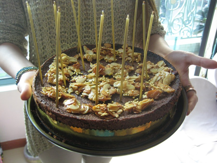 courtesy of Nigella spiced chocolate cake with addition of gold candles, small balls and Liz's handmade ribbon