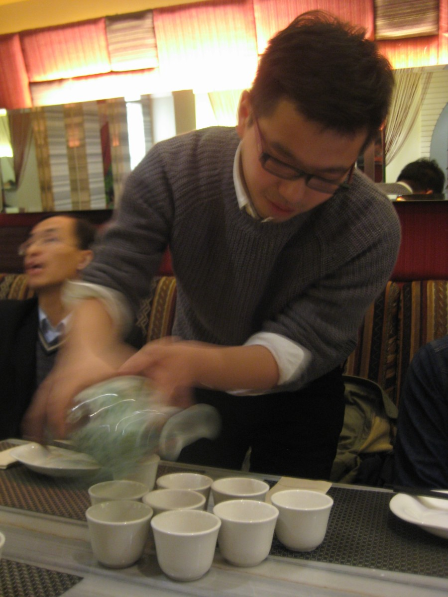 baijiu being poured, for some people the rest of the night was a blur [a happy one]
