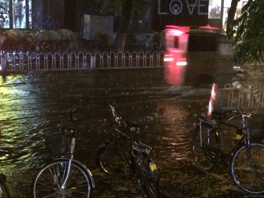dramatic thunderstorm - an hour of continuous lightning, localised ankle deep flooding and amongst it all an army of drain unblockers and people with suction machines ensured the city traffic halted for the merest second only